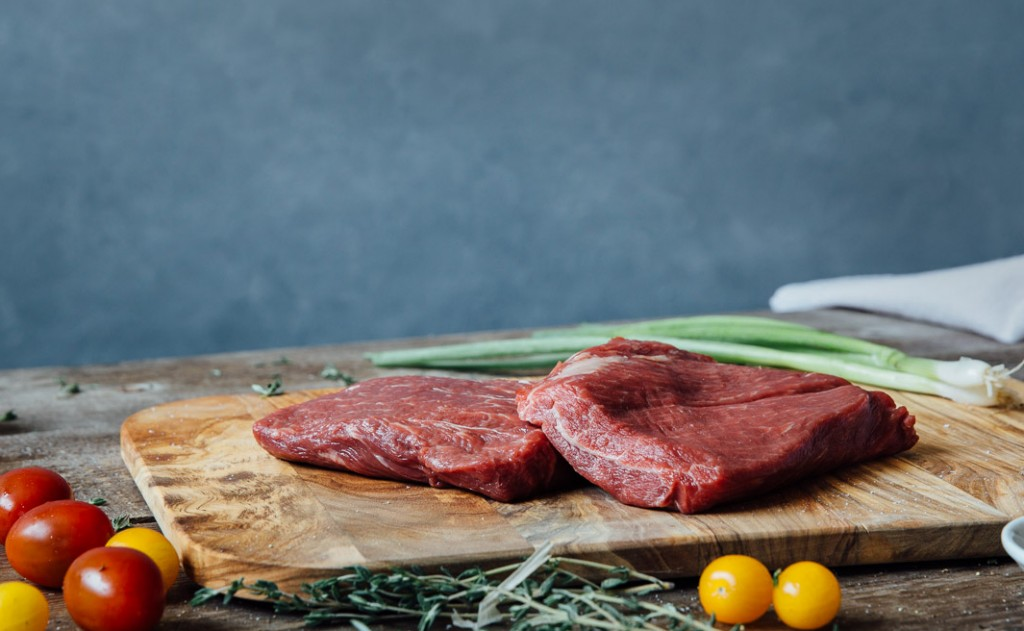 premier meat company wet aged flat iron beef steak raw tomatoes high quality proteins delivery fresh meat